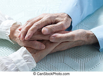 Old people holding hands closeup Elderly couple - Old people...