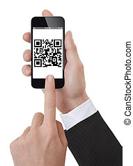 Hand Holding a Smartphone scanning qrcode - Studio Shoot of...