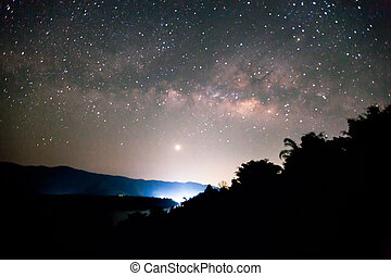 The Milky Way and venus rises over the mountain in...