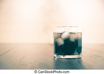 soft drink on wood background vintage style