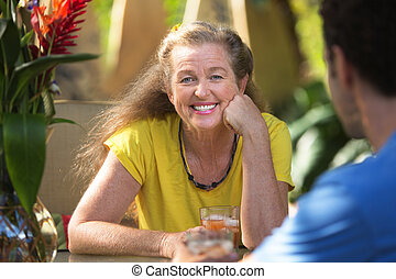 Cheerful Woman Having Drinks with Friend