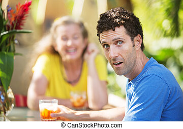 Dumbfounded Man with Woman on Vacation - Dumbfounded...