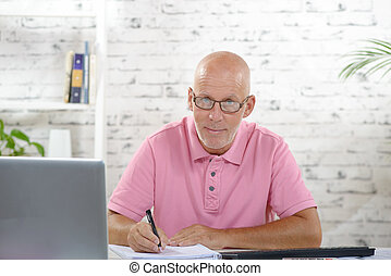 a businessman working in his office - a businessman with a...