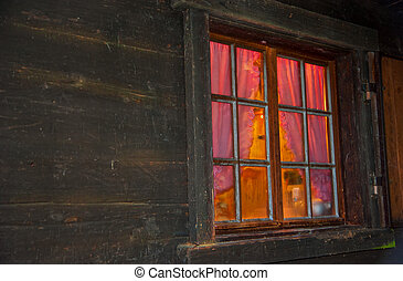 homely vibe behind the window with glazing bars of a log cabin