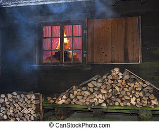 view through the window with glazing bars of a log cabin