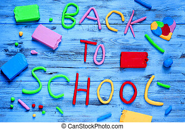 back to school written with modelling clay of different...