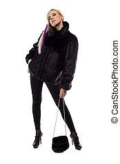 Photo of woman with fur bag, chin up on white background