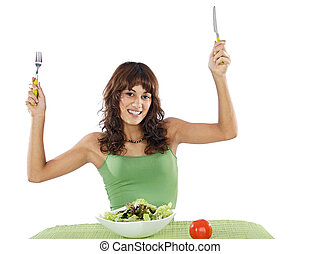 teenager eating salad - Pretty teenager eating salad over...