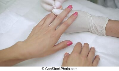 Manicure special liquid removes old red nail polish client -...