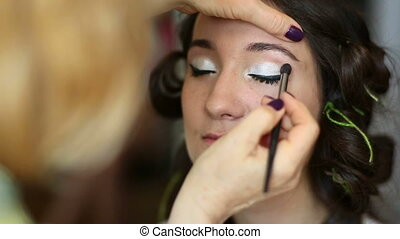 Make-up - Model making-up for photo session in studio,...