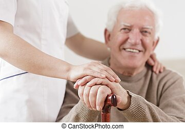Senior man and helpful nurse - Smiling senior man and...