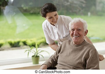 Man staying in nursing home - Smiling senior man staying in...