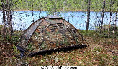 Small camouflage tent - Camouflaged tent stand up on shore...