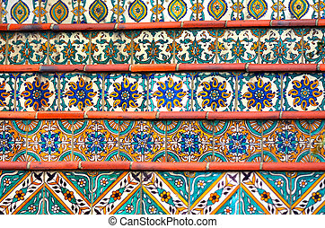 Colorful Spanish tiles decoration on stairway.background...