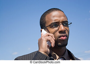 Concerned Business Man - A young African American man...