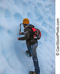 Mountain climber - A man climbs a wall with the ice pick. We...