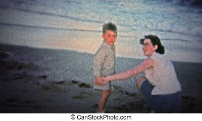 NANTUCKET. USA - 1957: mom and child at the beach - Unique...
