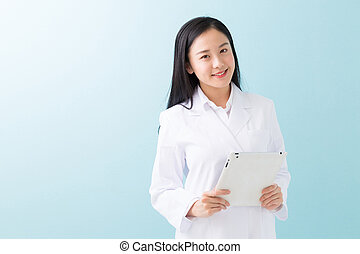 Woman in a white coat - Young attractive asian woman in a...