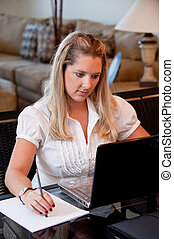 Woman at work - A young business woman working on her...