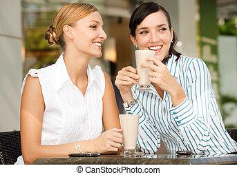 Businesswomen with Coffee - Two attractive businesswomen...