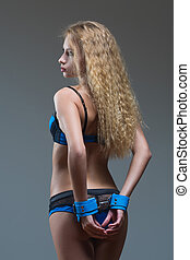 girl in handcuffs standing back. visible ass - sexy girl in...