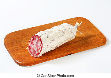 French Saucisson Sec on cutting board