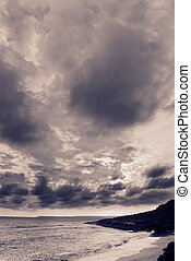 Dramatic clouds in sky over the coastline