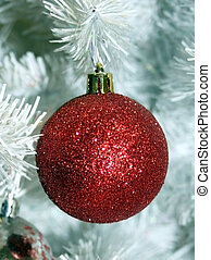 Red ball in white christmas tree