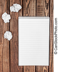 Blank notepad on a wooden surface