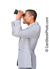 Young afro-american businessman using binoculars