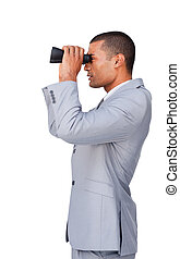 Confident businessman using binoculars against a white...