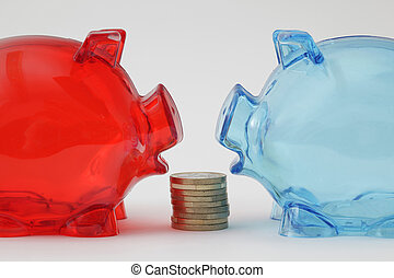 Two piggy banks face to face, with cion stack - Two piggy...