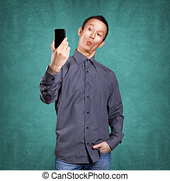 Asian Man Making A Selfie - Asian man making a selfie on...