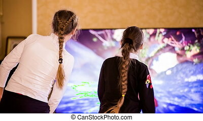 Two Female Videogamers Playing With Kinect - The shot was...
