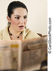 Shocked woman read bad news - Shocked young woman reading...