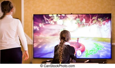 Female Videogamers Playing With Kinect - Two girls...