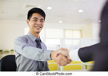 business man hand shaking in office