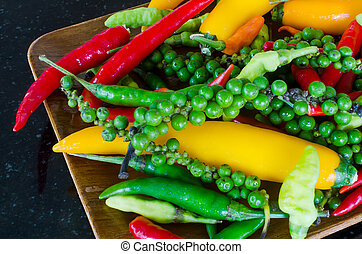 Colorful mix of the freshest and hottest chili peppers on...
