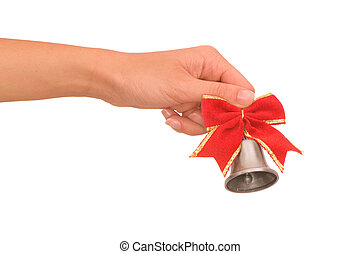 Handbell - Hand bell with red bow in the womans hand