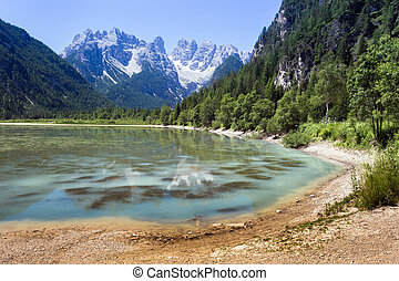 Lake, mountain and forrest in Italian Dolomiti