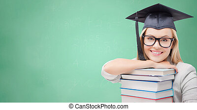 student in trencher cap with books over green - education,...