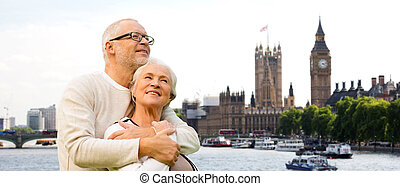 happy senior couple in london city - family, age, tourism,...