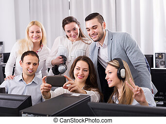 Successful business team making selfie with smartphone
