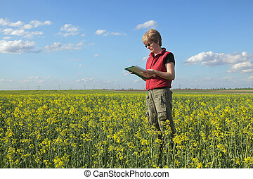 Agriculture, farmer or agronomist in oilseed field