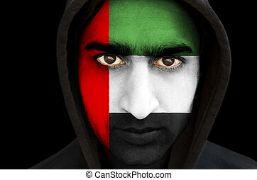 Man with UAE flag face paint - Closeup portrait of a man...