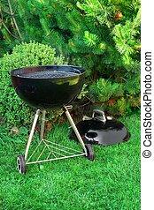 BBQ Kettle Grill Appliance On The Backyard - Empty New BBQ...