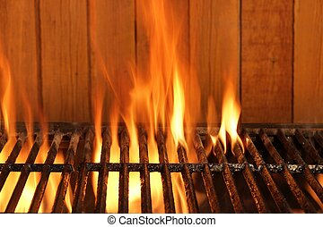 Flaming BBQ Charcoal Cast Iron Grill And Wood Background -...