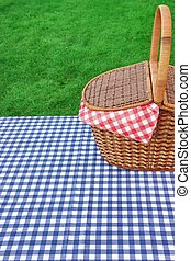 Outdoor Rustic Picnic Table With Hamper And Blue Tablecloth...