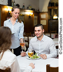 waitress with prepared meal at table - Charming waitress...