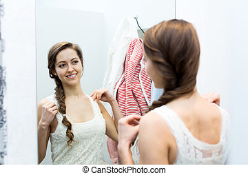 woman in the dressing room - Portrait of happy young female...